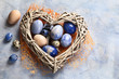 Leinwanddruck Bild - Easter eggs in heart shaped nest