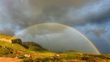 Rainbow on dark cloudy sky in Greece - 249647803