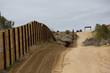 Quadro Border Patrol Vehicles Near Barrier Wall in California