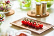 Close up of cherry tomatoes on the plates and spices on the background