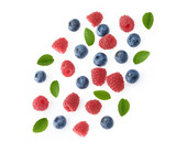 falling berries of raspberry and blueberry white background