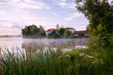 Church on pound bank with mist. - 249685250