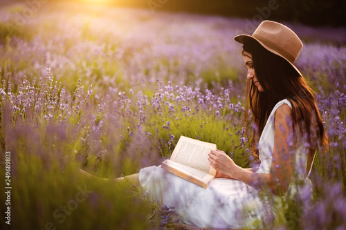Woman at lavender flower field in summer sunset - 249689803