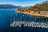 Aerial view of Lake Maggiore with boats in the harbor of Monvalle village, province of Varese, Italy
