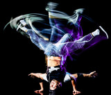 one chinese young man hip hop break dancer dancing isolated on black background with speed light painting effect motion blur - 249713863