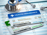 Health Insurance cards total and dental care with stethscope. - 249724033