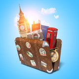 Trip to London, Great Britain.Vintage suiitcase with symbols of UK London, Big Ben tower and red booth. Travel and tourism concept.