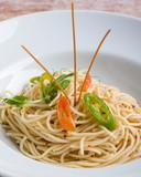 fresh spaghetti olio peperoncini pasta in white plate - 249740610