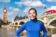 London city healthy active fitness woman running near Big Ben. Female runner girl jogging training. Asian athlete smiling happy on Westminster Bridge, London, England, United Kingdom. - 249746410