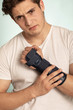 Man hand with adjustable immobilizer.