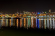 sydney city light reflecting on the water