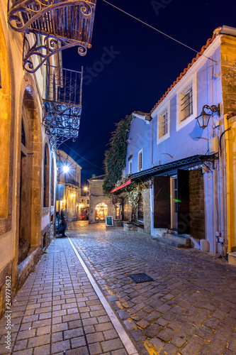 Picturesque narrow street and buildings in the old town of Xanthi, Greece. © gatsi