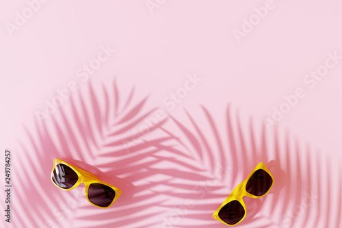 Yellow sunglasses with shadow of coconut leaves on pastel pink background. summer vacation concept. 3d rendering © aanbetta