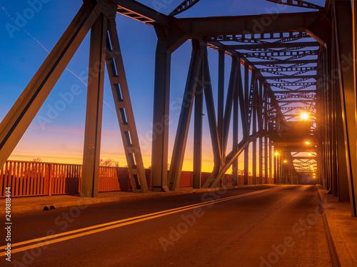 iron truss bridge at sunset