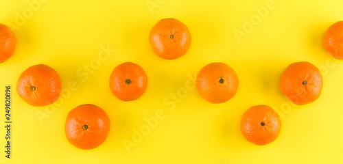 Fruit pattern of mandarin isolated on yellow background. Tangerine. Flat lay, top view. - 249820896
