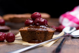 chocolate cupcake with a cherry
