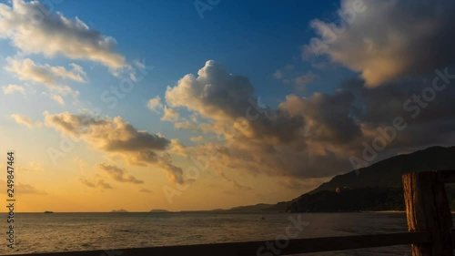 Sunset time lapse with moving clouds above the seascape
