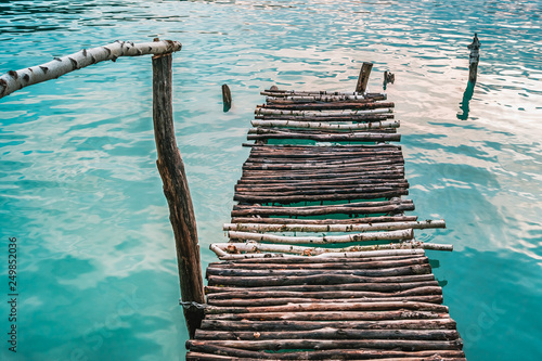 Acrylglas Pier Birch pier with handrail in turquoise water