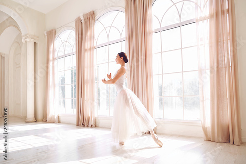 Young ballerina dancing in a white studio © Studio Romantic