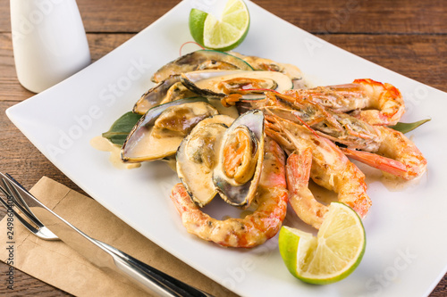Shrimps and mussels in a creamy sauce, ready-made dish, Asian cuisine, seafood, menu, restaurant - 249860405