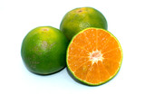 green oranges on white background - healthy fruit