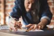 Leinwanddruck Bild - Young Asian man draft a drawing plan for artwork, architect, engineering drawing, creative designer concept