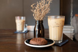 Ice Latte Coffeein a glass  with Chocolate Chip Cookie on a Wooden Table - 249882212