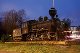 KOUVOLA, FINLAND - NOVEMBER 8, 2018: Old steam locomotive as an exhibit at the Kouvola railway station in Finland at night.