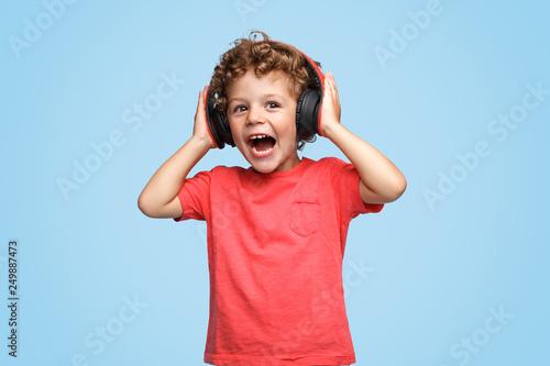 Loud boy listening to music