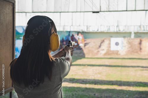 bae0cd43edf05 Young woman practice gun shoot on target | Buy Photos | AP Images ...