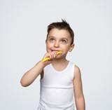 Dreaming boy brushing teeth - 249889422