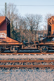 a rusty old cargo train with a red vintage look on a sidetrack