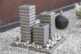 Fototapeta Kamienie - Brunnen aus Natur Stein im Garten © Thomas