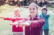 Quadro Young dark-eyed fitness trainer training retired women