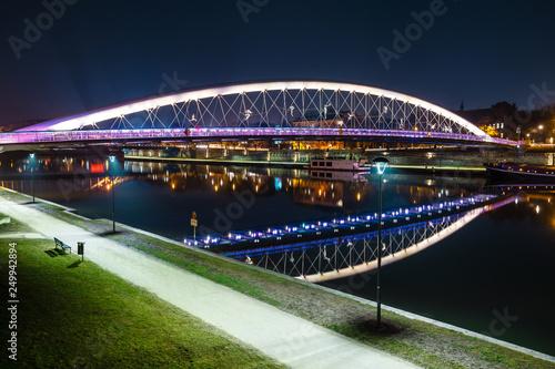 Bernatka footbridge over Vistula river at night, Krakow, Poland