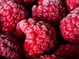 Close up of frozen raspberries, macro shot, top view