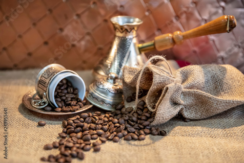 Copper cup, Turkish coffee concept with coffee beans. © mehmet