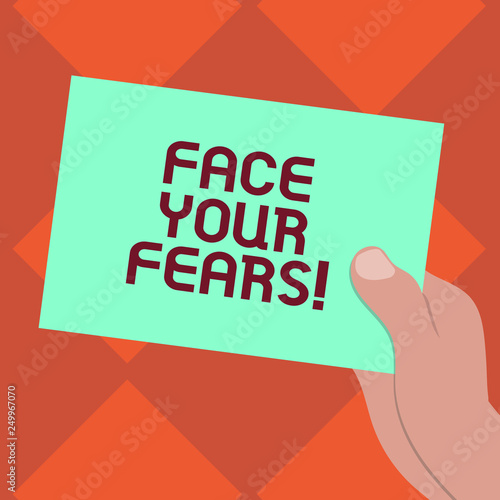 Handwriting text writing Face Your Fears. Concept meaning Have the courage to overcome anxiety be brave fearless Drawn Hu analysis Hand Holding Presenting Blank Color Paper Cardboard photo