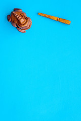 Buddhist symbol. Oriental wooden frog on blue background top view space for text © 9dreamstudio