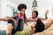 Quadro African american family spending time together at home. They are having fun