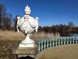 Decorative statue by the pond in Sharlottenburg garden in Berlin, Germany