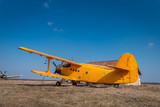 A big old yellow plane