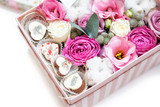 flowers with candy in box