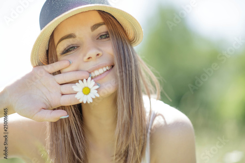Woman with daisies