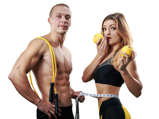 Athletic couple isolated. Muscular Man and Woman with measuring tape in gym. Weight loss, bodybuilding, sport and fitness, coach, workout, dieting and health. - Image © kuznetsov_konsta