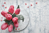 Bunch of light link tulips on light textured background, text space
