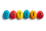 colored eggs with letters forming the word