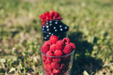 The fresh berries in the transparent glass for background