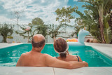 senior couple relaxing in spa pool - 250034059