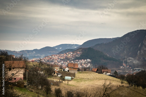 Mountain range near the Uzice town in Serbia. Winter cloudy day. © Milan